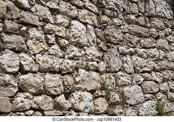 Rough historic stone wall - csp10991433