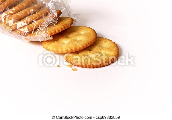 round butter crackers in open package - csp69382059