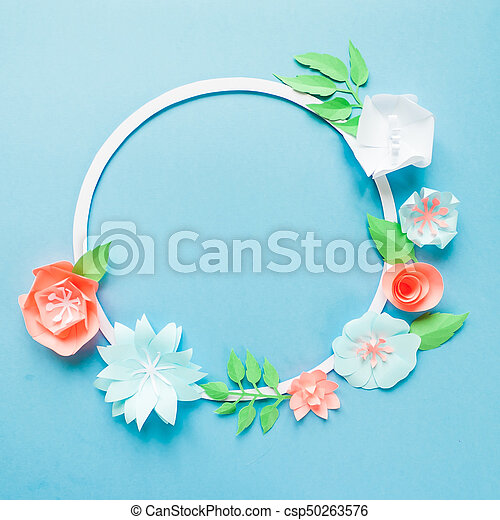 Round frame with color paper flowers on the blue background flat round frame with color paper flowers on the blue background flat lay nature concept cut from paper place for your text mightylinksfo