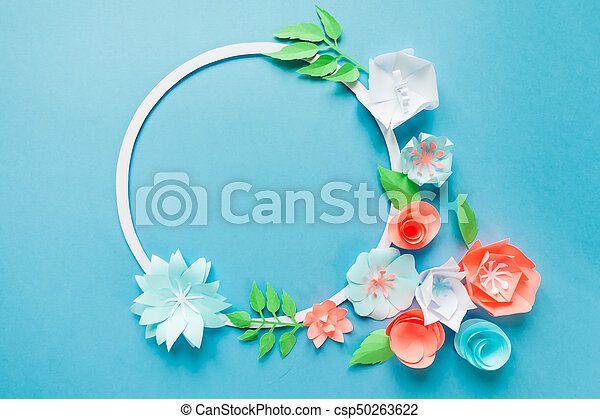 Round frame with color paper flowers on the blue background round frame with color paper flowers on the blue background flat lay nature concept mightylinksfo
