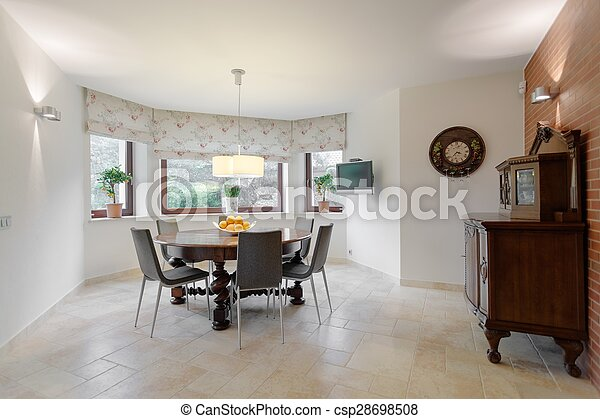 Round table in dining room - csp28698508