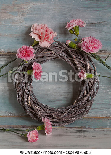 Round Wreath Of Dry Branches With Pink Flowers Frame On Blue
