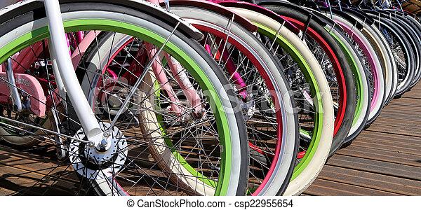 row multicolored bicycle wheels closeup   - csp22955654
