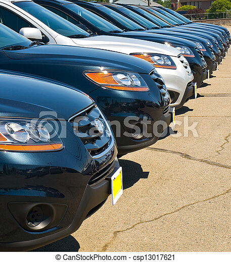 Row of Automobiles on a Car Lot on a Bright Sunny Day - csp13017621