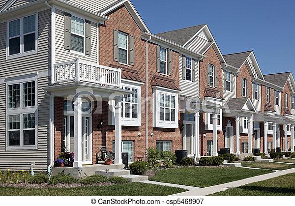 Row of brick townhouses - csp5468907