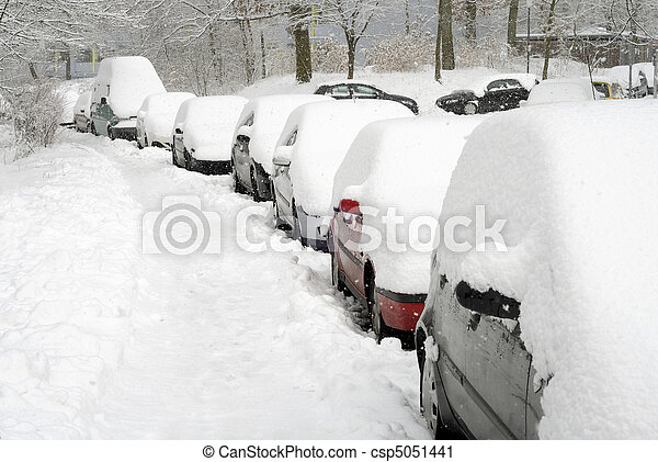 Row of cars covered in snow - csp5051441