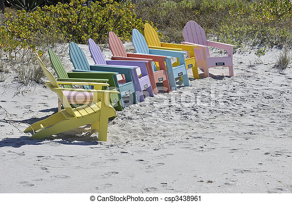 Row of Colorful Adirondack Chairs on the Beach