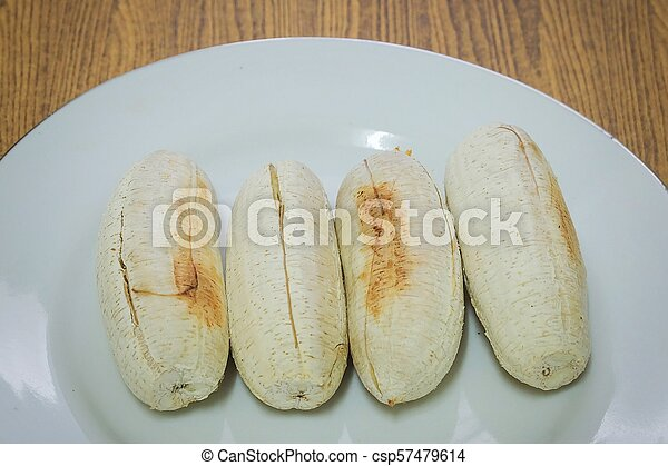 Row of Grilled Bananas on A Dish - csp57479614