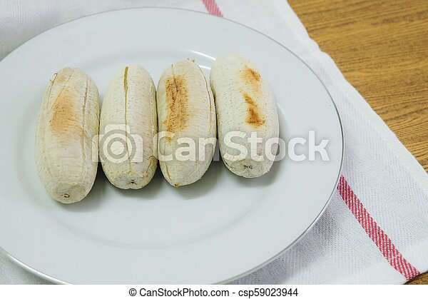 Row of Grilled Bananas on A Dish - csp59023944