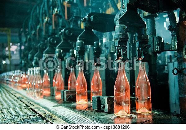 Row of hot orange glass bottles  - csp13881206