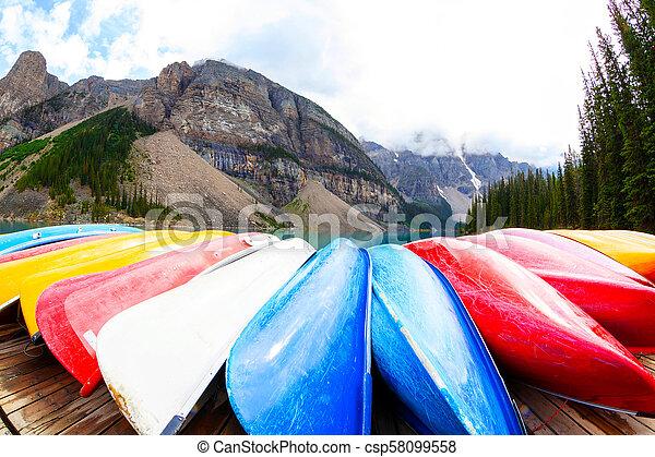 Row of Kayaks on Moraine Lake in the Canadian Rockies - csp58099558