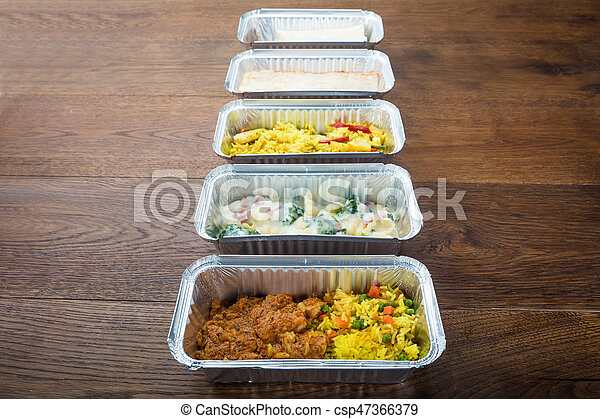 Row Of Take Away Dishes On Wooden Table - csp47366379