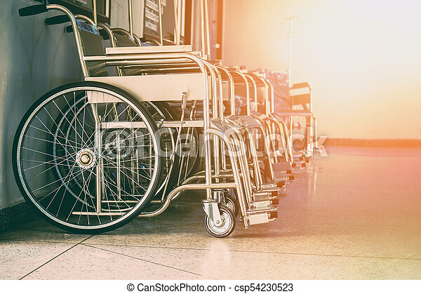 Row Wheelchairs in the hospital ,Wheelchairs waiting for patient services. - csp54230523