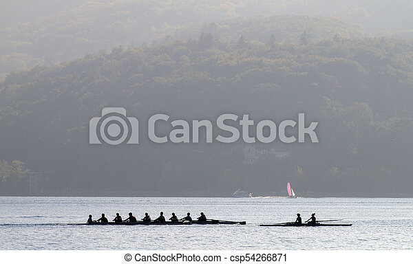 Rowers on row boat, Annecy lake, france - csp54266871