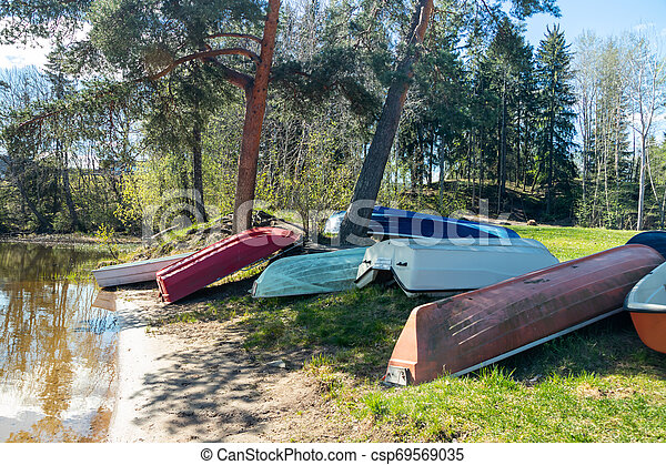 Rowing boats on coast of river at spring. - csp69569035