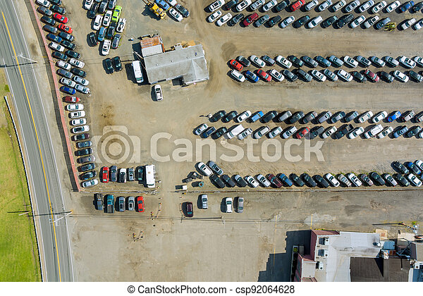 Rows of auction lot on cars parked in car parking - csp92064628