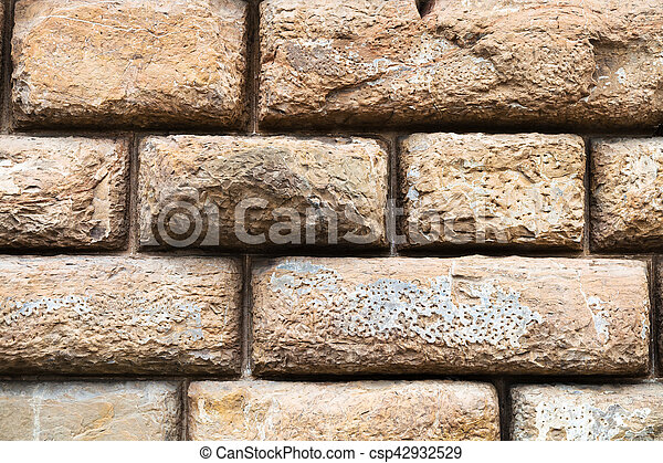 rows of brown blocks in wall of Palazzo Pitti - csp42932529