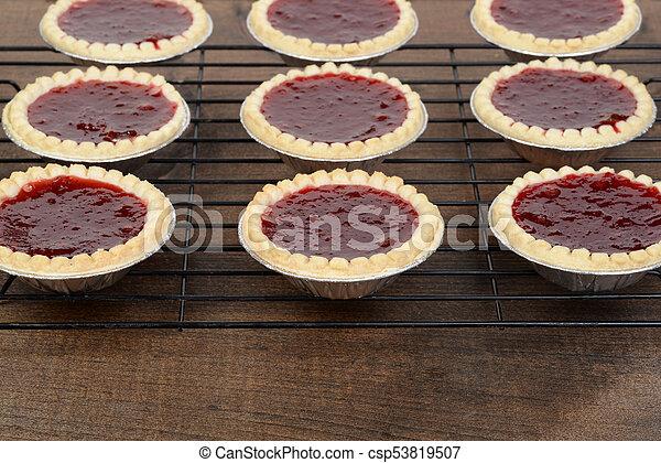 rows of strawberry tarts - csp53819507