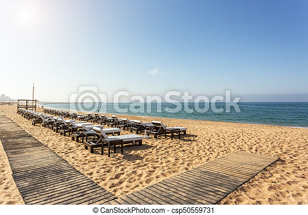 Rows Of Sunbeds For Sunbathing On The Beach In The Algarve