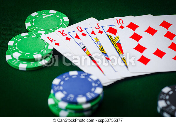 Royal flash and poker chips on green casino table. gambling success - csp50755377 & Royal flash and poker chips on green casino table. gambling ...