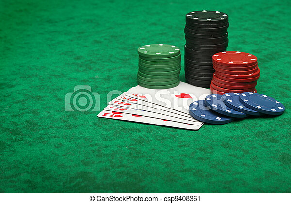 Royal Flush with gambling chips over green felt - csp9408361