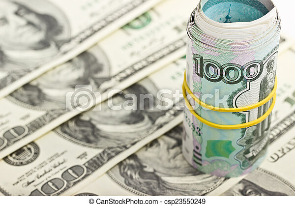 Ruble rolled into a tube on a background of dollars - csp23550249