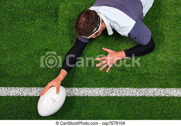 Rugby player scoring a try with one hand on the ball - csp7678104