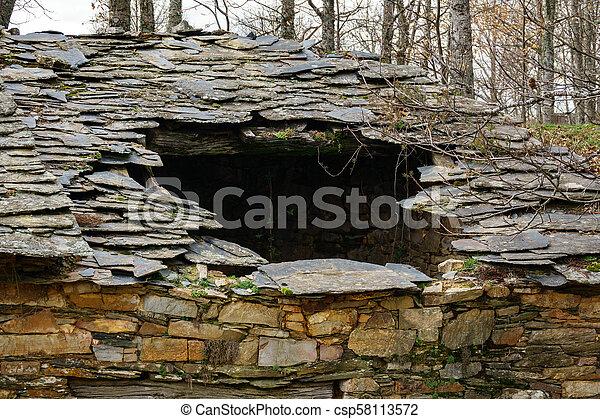 Ruined slate roof - csp58113572