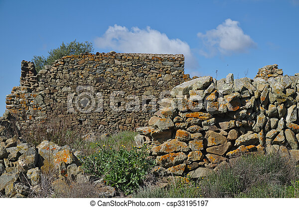 Ruined wall from a forgotten farm - csp33195197