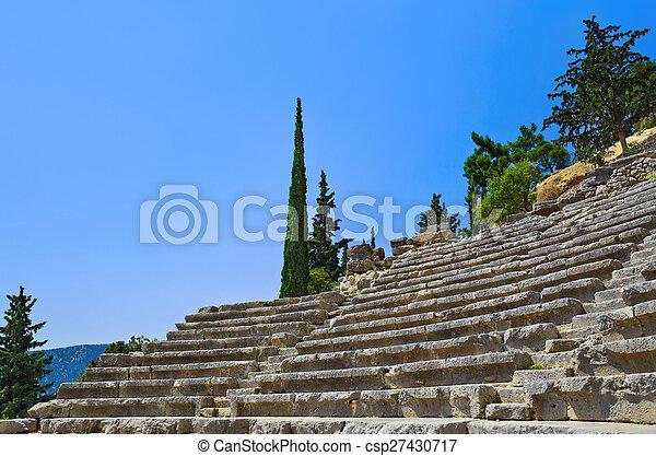 Ruins of amphitheater in Delphi, Greece - csp27430717
