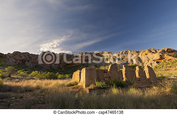 Ruins of old house with a mountain and clouds in the background - csp47465138