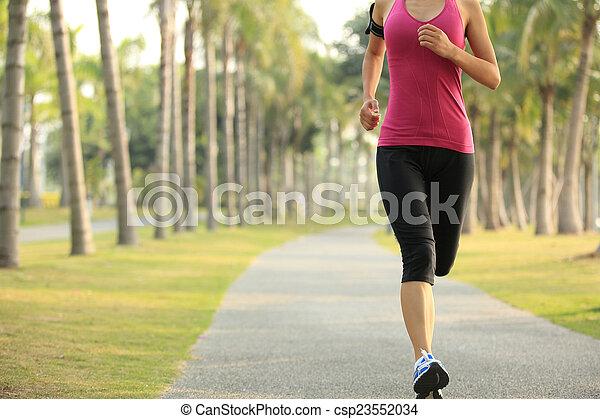 Runner athlete running - csp23552034