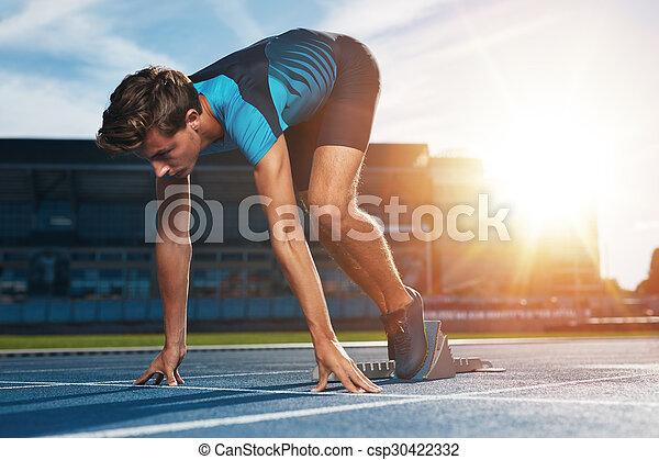 Runner on the mark at starting line - csp30422332