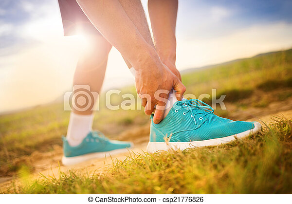 Runner with injured ankle - csp21776826
