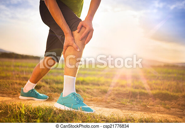 Runner with injured knee - csp21776834