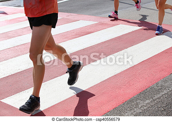 runners during a marathon race in the city - csp40556579