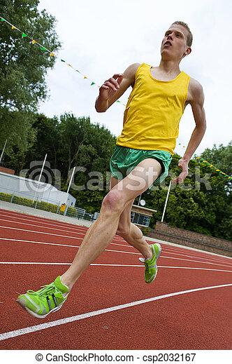 Running athlete in mid-air - csp2032167