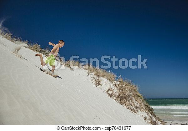 Running Down a Sand Dune - csp70431677