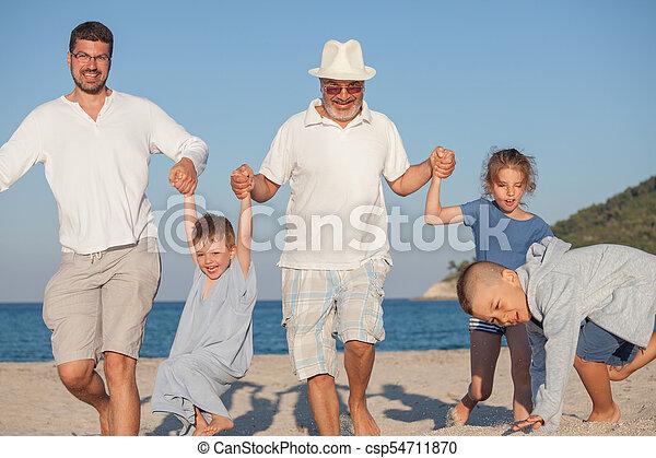 Running Generations Grandfather Kids Father Fun - csp54711870