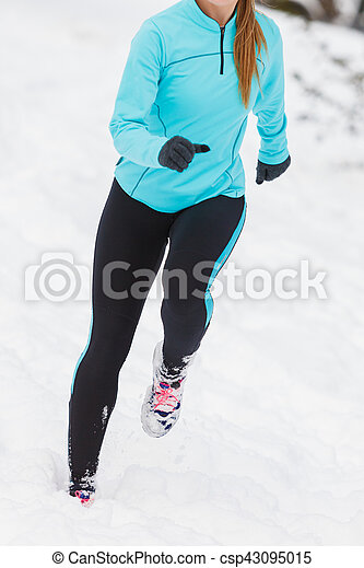 Running lady legs, sporty clothes, winter fitness - csp43095015