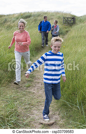 Running to the beach - csp33709583