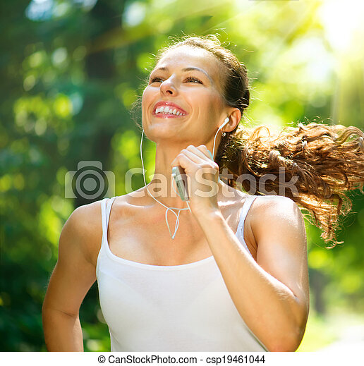 Running woman. Outdoor Workout in a Park - csp19461044