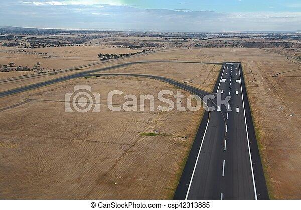 Runway of an airport - csp42313885