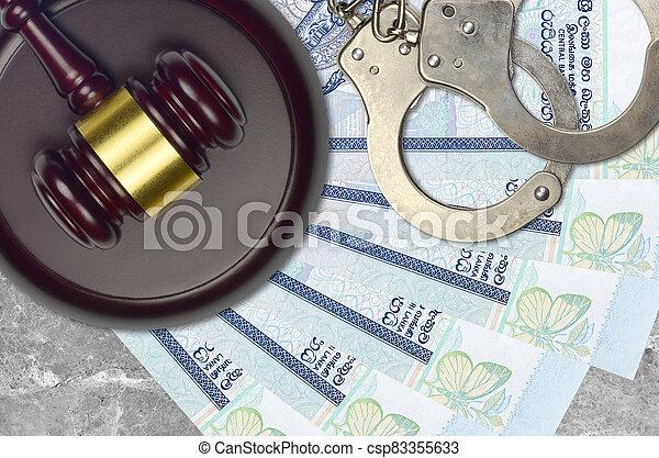 rupees, judiciaire, concept, police, juge évaluation, impôt, ou, tribunal, lankan, menottes, factures, marteau, 50, sri, bribery., desk., action éviter - csp83355633