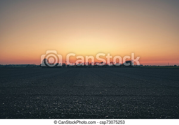 Rural countryside landscape with a farm - csp73075253