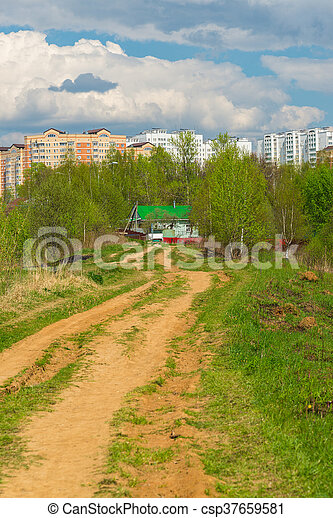 Rural house on background of the city - csp37659581