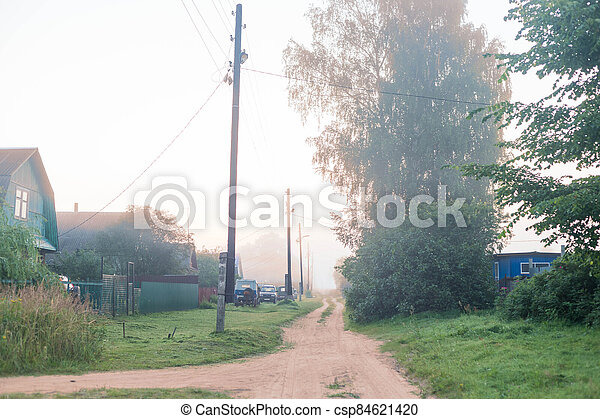 Rural landscape on a early foggy morning in the village. - csp84621420