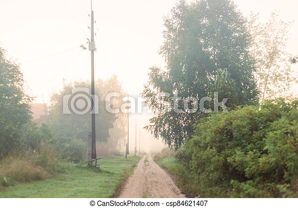 Rural landscape on a early foggy morning in the village. - csp84621407