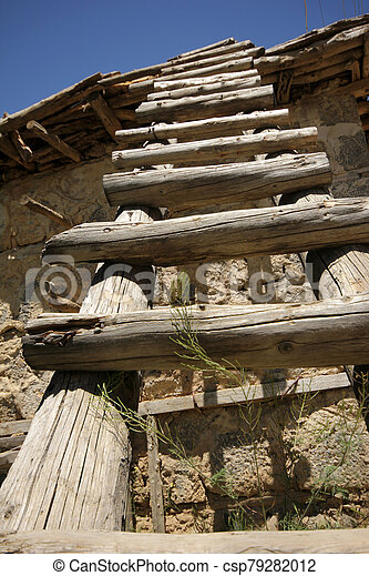 Rural landscape with stairs and old stone building - csp79282012