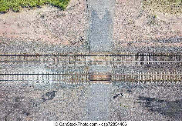Rural railroad crossing aerial view - csp72854466